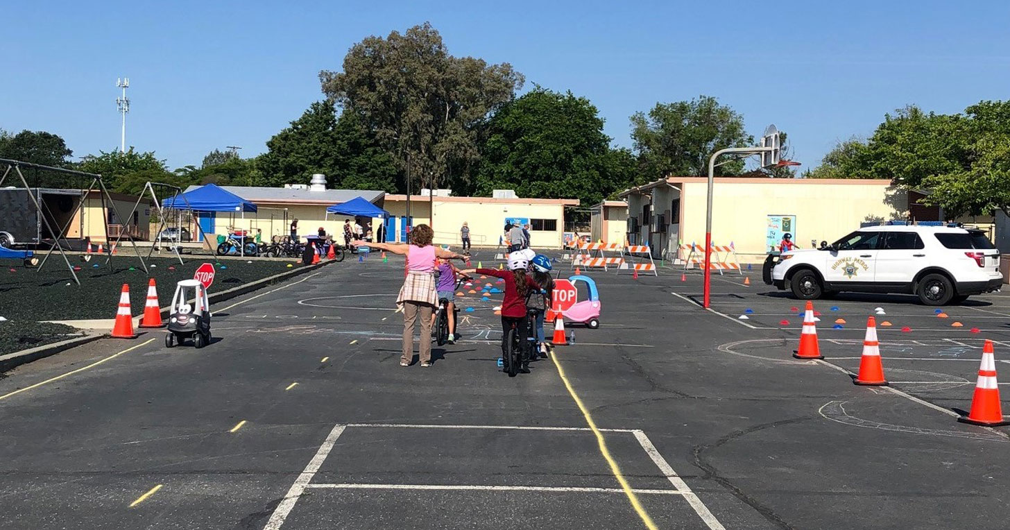 Kids learning bike safety at school